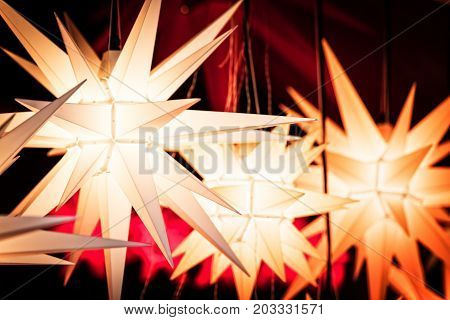 Brightly Paper Star Lamps, Lantern, Handmade Crafts On The Christmas Market