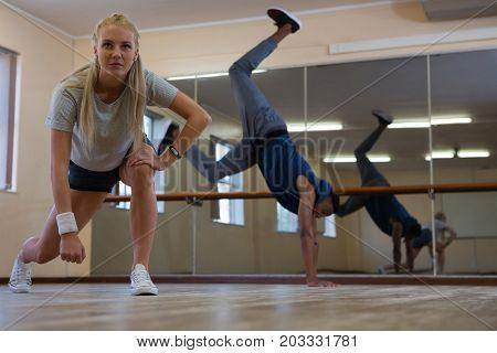 Young dancers practicing on wooden floor at studio