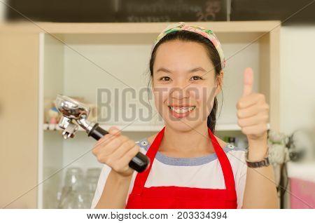 Asian woman barista preparing service in the coffee shop