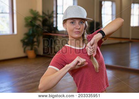 Portrait of beautiful woman practicing dance on floor in studio