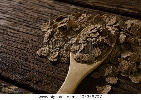 Close-up of chocolate flakes scattered from spoon
