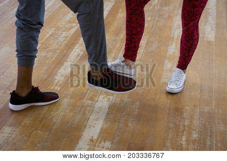 Low section of dancers practicing on floor in studio