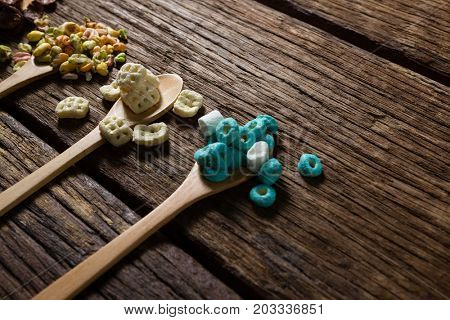 Various breakfast in spoon on wooden table