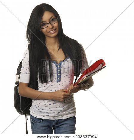 Young woman holding school college supplies and backpack