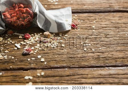 Close-up of jar with dry fruit on wooden table