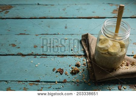 Fruit cereal in jar with napkin cloth on a wooden table