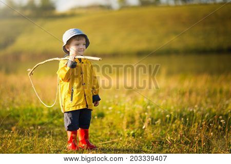 Child Boy With Fishing Rod Ready For Fishing