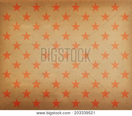 Vintage red stars pattern wrapping paper on a gold background