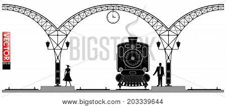 An Ancient Arched Metal Building Of The Railway Station. People And Steam Locomotiv On The Platform.