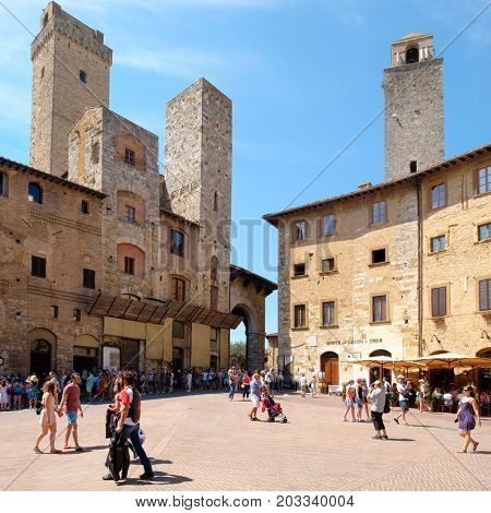 SAN GIMIGNANO,ITALY - JULY 23,2017 : Tourists and locals at the medieval hill town of San Gimignano in Tuscany