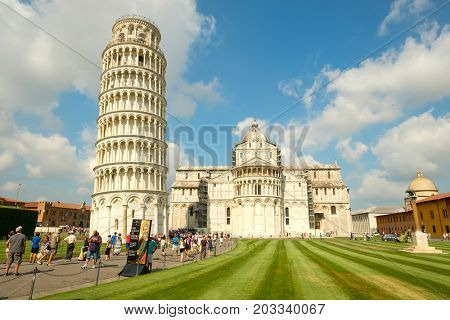 PISA,ITALY - JULY 23,2017 : The Cathedral and the Leaning Tower in the city of Pisa, Tuscany, Italy