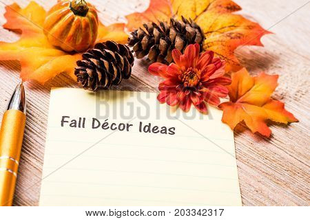 Fall Decor list concept on notebook and wooden board