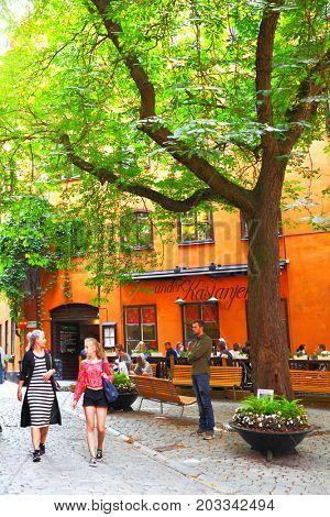 Stockholm, Sweden - July 25, 2017: Street with old chestnut in Gamla Stan in Stockholm