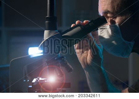 Doctor examines patient tissue samples
