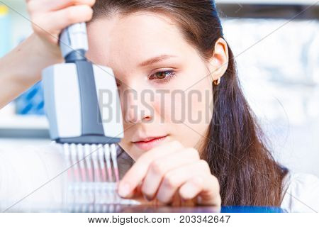 Female technician doing science experiment