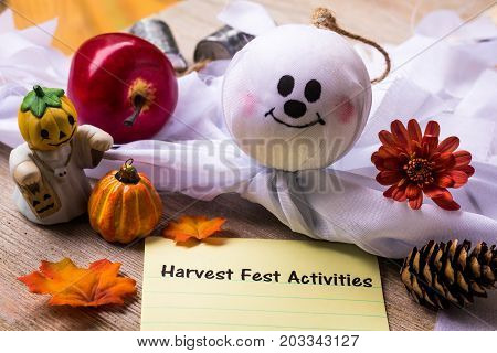 Harvest Fest Activities list concept on notebook and wooden board