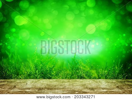 A Thuja green background behind wooden table