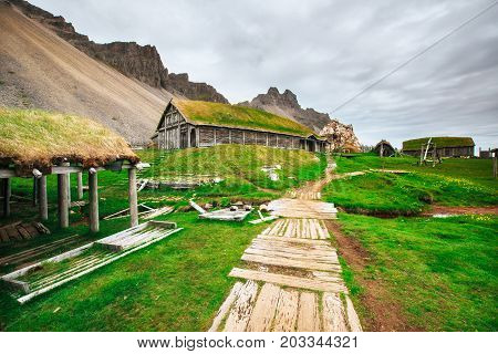 Traditional Viking village. Wooden houses near the mountain first settlements in Iceland