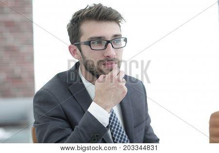 closeup. successful businessman in the workplace