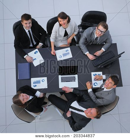 team of accountants sitting behind a Desk