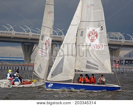 ST. PETERSBURG, RUSSIA - JUNE 27, 2017: Athletes compete in the final of Saint Petersburg University Open Cup. It's the only students' sailing regatta in the city