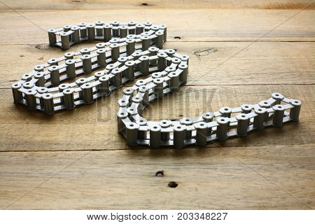 A Bicycle Chain on a Wooden  Background