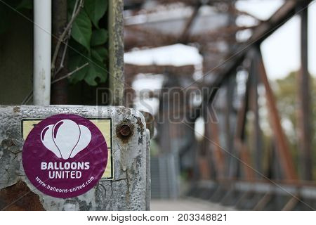 MAGDEBURG, GERMANY - SEPTEMBER 9, 2017: At an old railway bridge in Magdeburg hangs a sticker with the inscription Balloons United.