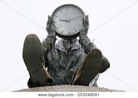 MAGDEBURG, GERMANY - SEPTEMBER 9: Statue in Magdeburg: A man in business suit is looking at a big clock. (Magdeburg is the sister City of Nashville, USA)