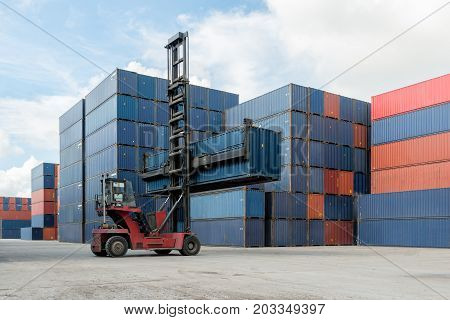 Forklift lifting container box loading to container depot use for cargo import export logistics background.