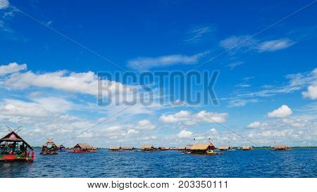 Bamboo rafting with blue sky travel in Thailand.