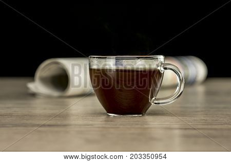 Coffee And Newspaper On Table
