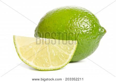 Green Lime  With Slice Of  Juicy Lime Isolated On White Background
