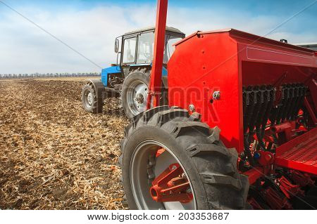 Modern tractor with sowing complex on the field. The concept of work in a fields and agriculture industry.