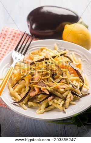 pasta with smoked salmon and eggplant, selective focus