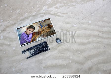 Asian girl and sea turtles on the computer screen on the beach Marine conservation concept