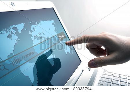human fingers on the Tablet PC with network search