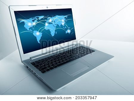 open laptop with internet connection on a grey background
