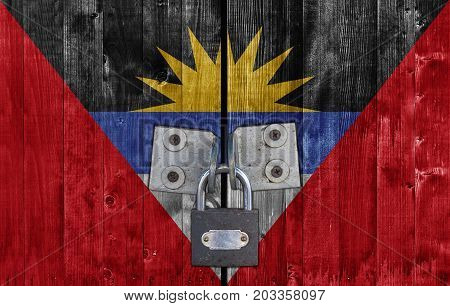 Antigua Barbuda flag on door with padlock