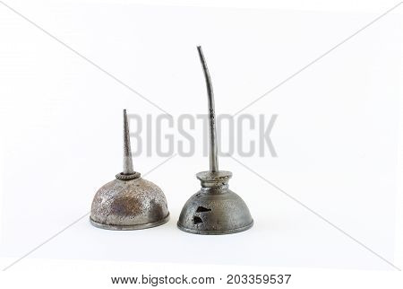 Two steel oil cans of different heights isolated on white