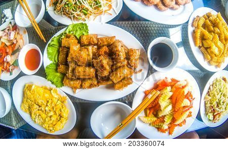 vietnamese food on table, spring rolls, eggs, shrimps