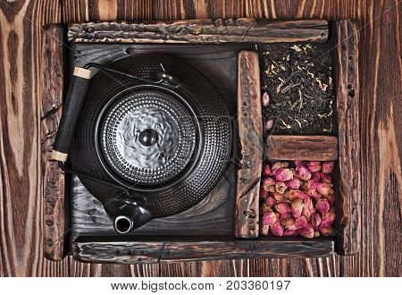 Asian Black Traditional Teapot With Dry Tea And Rose In Vintage Wooden Box