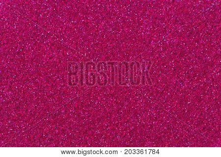 Crimson glitter background. High quality texture on macro.