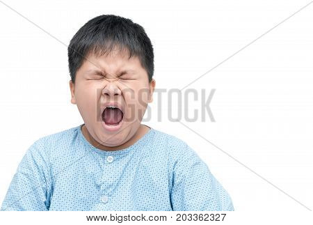 Obese Asian Child Yawning Isolated On White