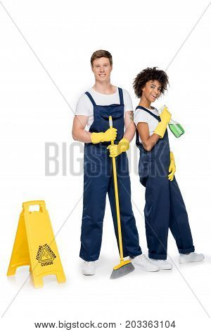 Smiling Multiethnic Cleaners With Cleaning Supplies