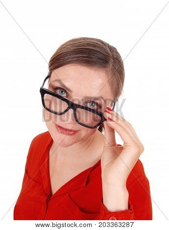 A young afraid looking woman with her hands on her glasses standing isolated for white background