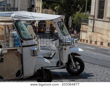 White Tuk-Tuk Urban Vehicles for Tourists Transportation in Lisbon Portugal