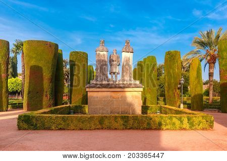 Stone Statues of Christopher Columbus and Catholic Monarchs, Queen Isabella I of Castile and King Ferdinand II of Aragon, in the gardens of the Alcazar in Cordoba, Andalusia, Spain