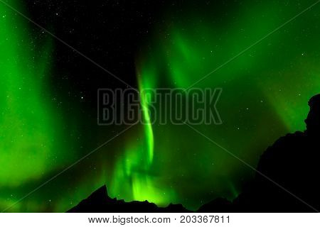 A beautiful green Aurora borealis or northern lights Norway selective focus