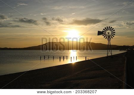 a wind vane staring at a sunset