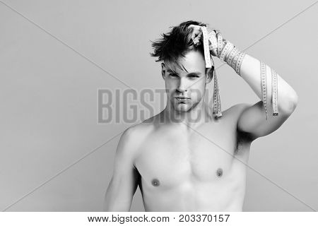 Man With Serious Face Checks Hair. Guys With Measuring Tapes